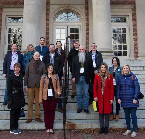 Photo of The Innovation Mission group stand in front of Carroll Hall, home of the UNC School of Media and Journalism.